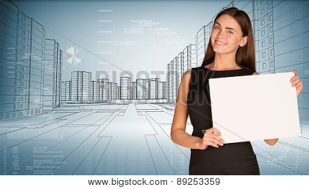 Businesswoman holding blank paper