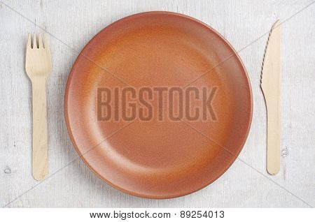 Empty Plate, Wooden Fork And Knife