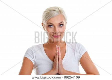blonde woman with holding her palms together