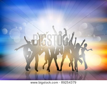 Silhouettes of people dancing on a summer background
