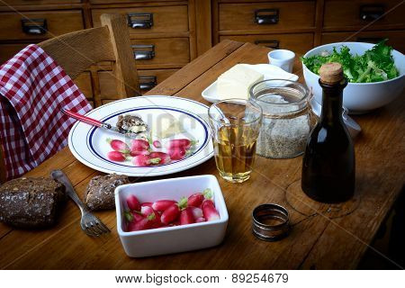 Plate With Radish, Butter And Salad On A Table
