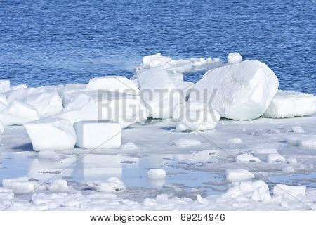 Blocks of ice and snow on the shore.