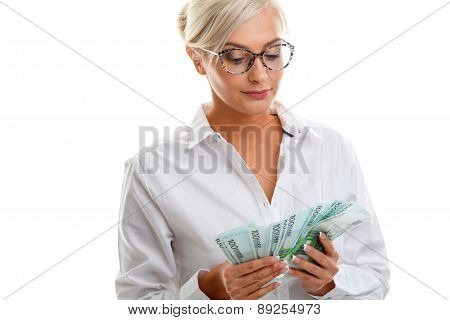 seriously young woman holding euro bills