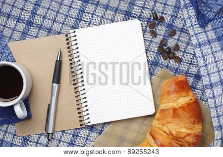 Notepad, Croissant And Coffee