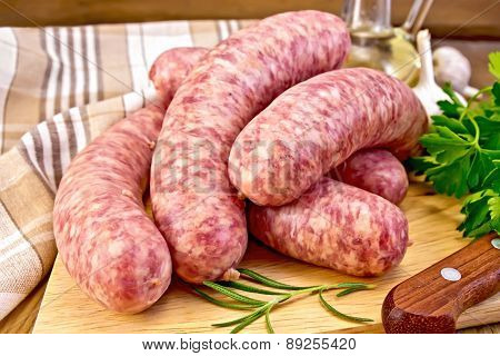 Sausages pork on board with knife