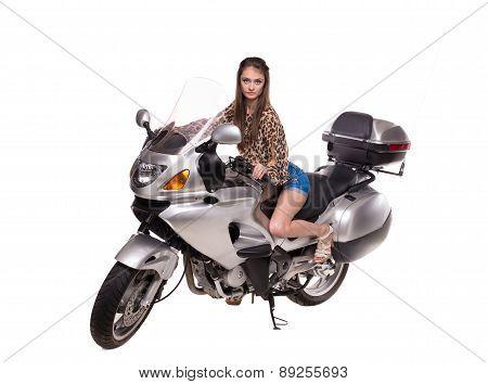 Fashion model sitting near motorbike