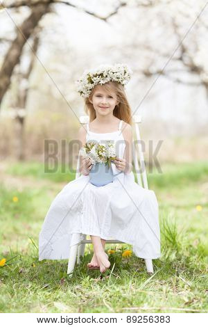 Beautiful girl in a flourishing orchard. spring