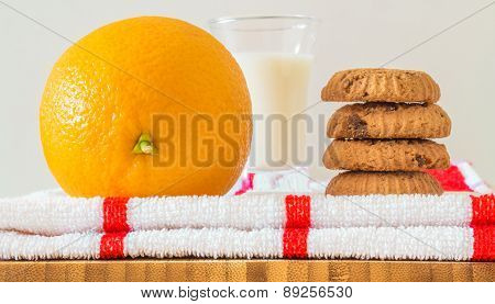Breakfast tray: cookies, milk and orange