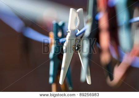 Plastic Clothespins In A Row On A Washing Line, Close Up With Copy Space