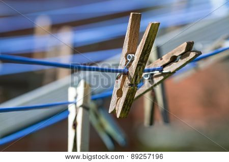 Wooden Clothespins On A Washing Line, Close Up