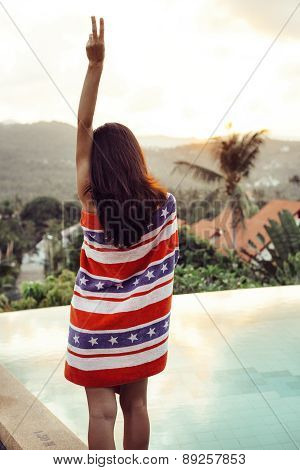 Pretty Woman Posing Beside  Swimming Pool On Sunset