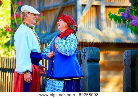Mature Ukrainian Couple In Traditional Costumes Talking In Village