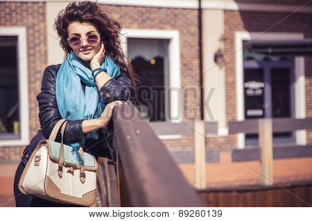 Brunette Beautiful Stylish Caucasian Woman In Casual Outfit On A Walk On European City Street. Copy