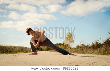 Man Practices Asanas On Yoga In Harmony With Nature
