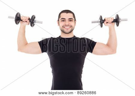 Young Strong Man In Black Sportswear Doing Exercises With Dumbbells Isolated On White
