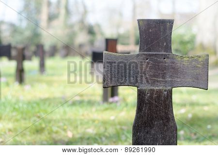 Dark Wooden Cross On A Military Cemetery