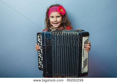 girl seven years of European appearance with a bright-haired chi