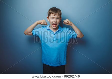 teenager boy brown European appearance in blue t-shirt shows the