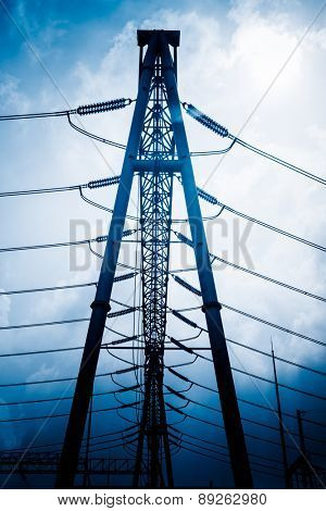 High voltage towers with sky background.