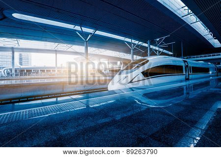 speeding train away from railway station, shanghai china.