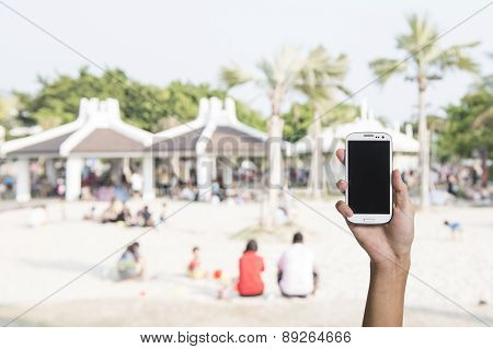 Using smartphone in a outdoor or street, closeup image.