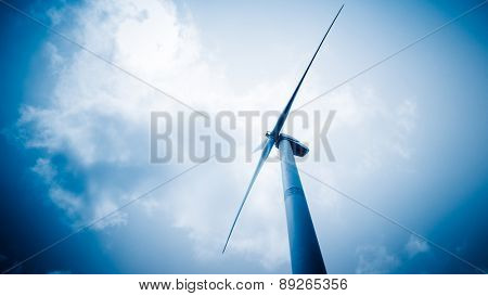 wind generators aganist the blue sky, blue toned.