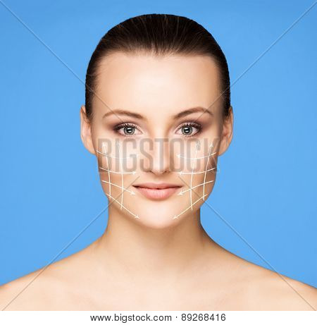Portrait of beautiful, fresh, healthy and sensual girl. Arrows on the face.