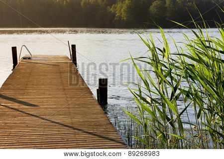 Lake and pier at summer morning