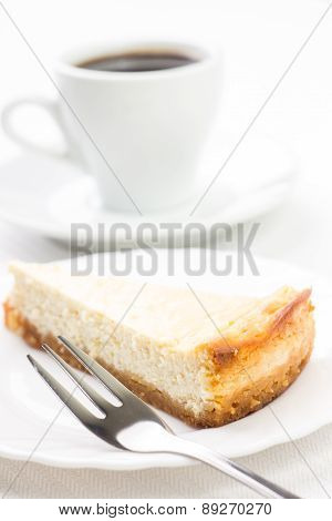 Wedge Of Cheesecake With Dessert Fork And Cup Of Coffee