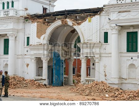 KATHMANDU, NEPAL - APRIL 26, 2015: Narayanhiti palace (the royal palace residence) entrance is damaged after a 7.8 earthquake hit Nepal on 25 April 2015.