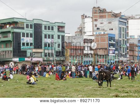 KATHMANDU, NEPAL - APRIL 25, 2015: People gather on an open ground at Chuchepati just after the 7.8 earthquake hit Kathmandu