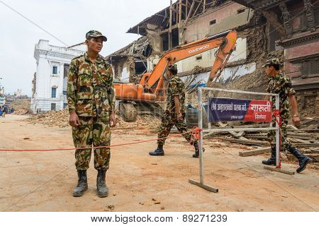 KATHMANDU, NEPAL - APRIL 26, 2015: Military forces starts the rescue effort at Durbar Square which is severly damaged after the major earthquake on 25 April 2015.