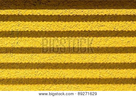 Wall Of Yellow Color With Fittings Shadow Strips