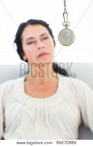 Woman being hypnotized on white background