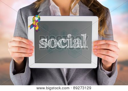 The word social and businesswoman showing a tablet pc against blue medical interface with icons