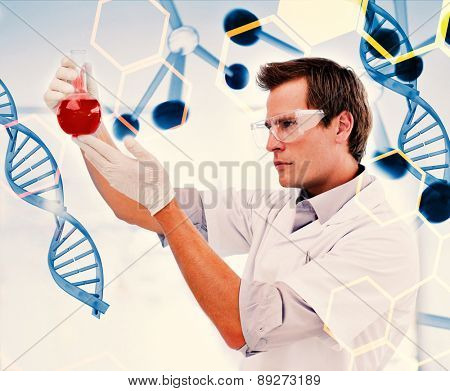 Science and medical graphic against biologist examining a beaker of blood