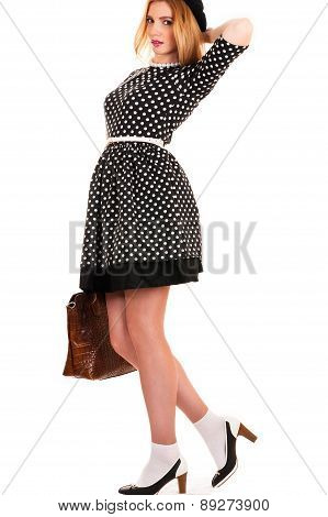 fashionable young woman with a bag in hands