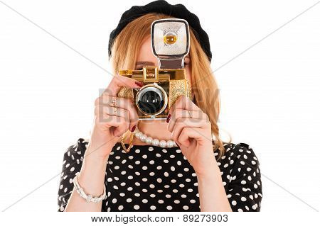 young fashion photographer with camera