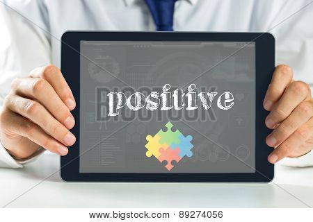 The word positive and autism awareness jigsaw against medical biology interface in blue