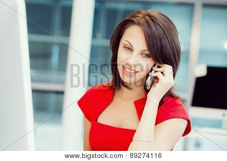 Modern business woman with mobile phone