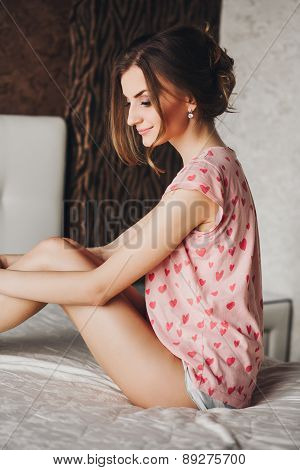 beautiful girl with long hair in pajamas
