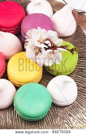 macaroon and marshmallow on a vintage silver tray
