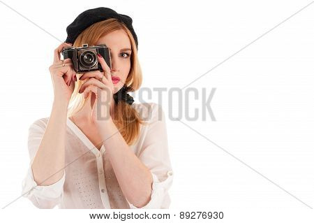 beautiful fashionable woman photographing retro camera