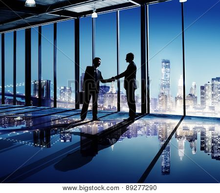 Businessmen Shaking Hands Indoors City As A Background Concept