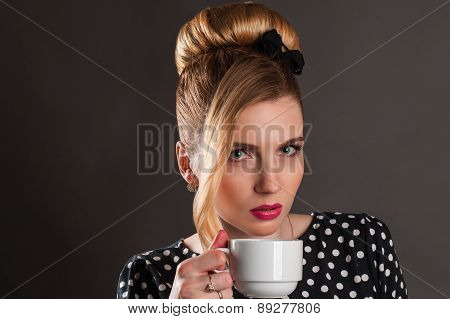retro woman with a cup of coffee