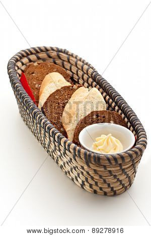 Basket of Sliced Bread with Butter