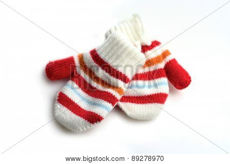 Baby gloves on white background