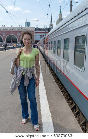 woman posing on the railway platform closeup portrait