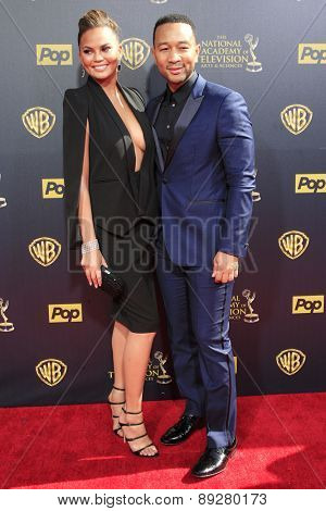 BURBANK - APR 26: Chrissy Teigen, John Legend at the 42nd Daytime Emmy Awards Gala at Warner Bros. Studio on April 26, 2015 in Burbank, California