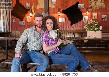 man and woman sitting on a bench in saloon